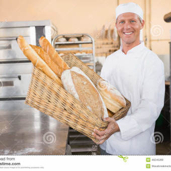 http://www.dreamstime.com/royalty-free-stock-images-baker-showing-basket-bread-kitchen-bakery-image49245289